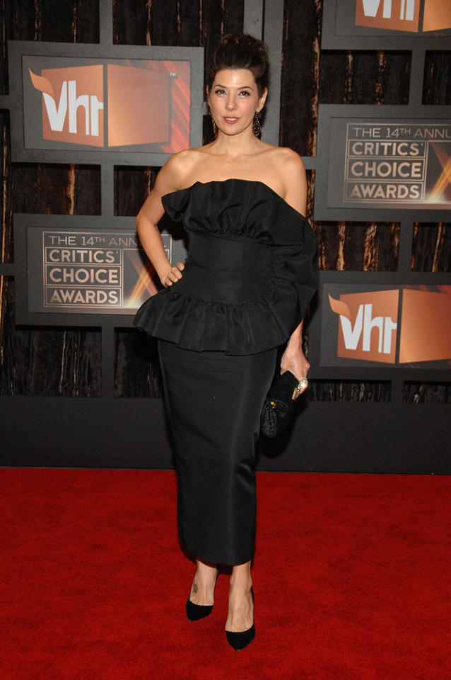 """<a href=""""http://movies.yahoo.com/movie/contributor/1800024659"""">MARISA TOMEI</a>  Critic's Choice Awards  Grade: C-    The strange, horseshoe-shaped ruffles on this strapless black Giambattista Valli, along with too-tall updo, make Marisa look like she's going to senior prom, not an awards show."""