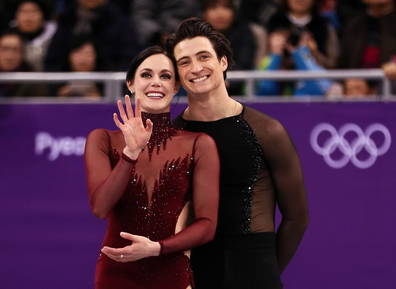<p>Gold medal winners Tessa Virtue and Scott Moir of Canada celebrate during the victory ceremony for the Figure Skating Ice Dance Free Dance on day eleven of the PyeongChang 2018 Winter Olympic Games at Gangneung Ice Arena on February 20, 2018 in Gangneung, South Korea. (Photo by Jamie Squire/Getty Images) </p>