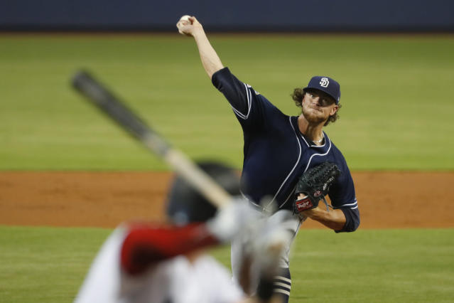 San Diego Padres' Chris Paddack pitches to Miami Marlins' Garrett Cooper during the first inning a baseball game Wednesday, July 17, 2019, in Miami. (AP Photo/Wilfredo Lee)