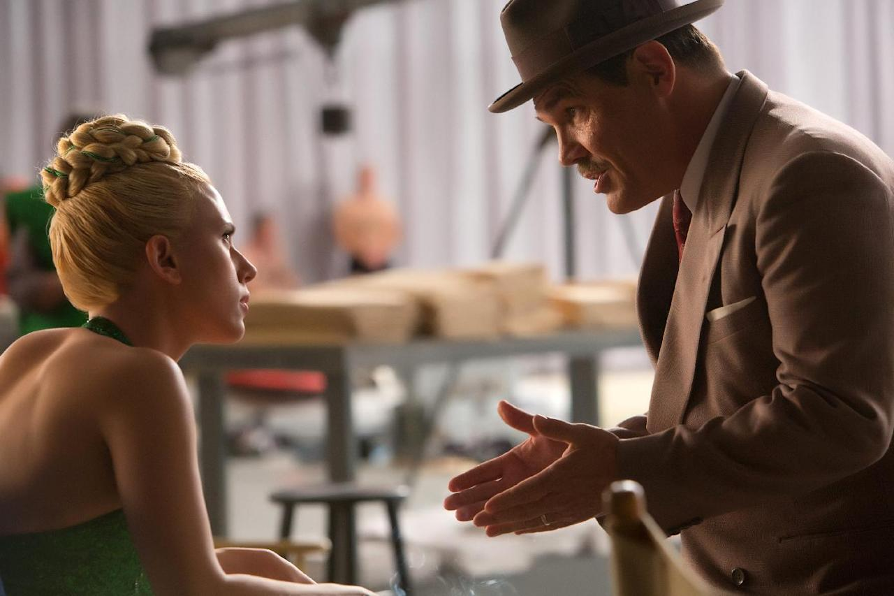 """In this image released by Universal Pictures, Scarlett Johansson, left, and Josh Brolin appear in a scene from """"Hail, Caesar!."""" (Alison Rosa/Universal Pictures via AP)"""