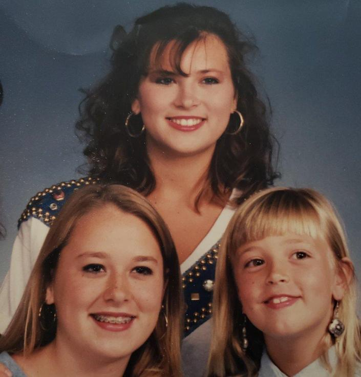 Amy Carlson (C) and her two younger sisters Tara (L) and Chelsea (R)