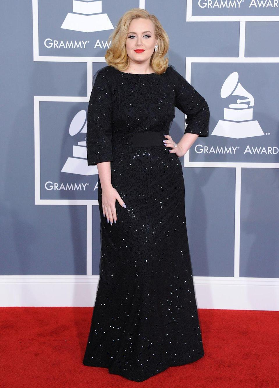 <p>The singer showed she meant serious fashion business at the 2011 Grammys in this glittering Armani Privé gown. </p>