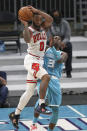 Chicago Bulls guard Coby White, left, collides with Charlotte Hornets guard Terry Rozier (3) during the second half of an NBA basketball game in Charlotte, N.C., Thursday, May 6, 2021. (AP Photo/Nell Redmond)