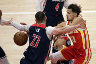 Atlanta Hawks guard Trae Young (11) passes the ball around Washington Wizards center Alex Len (27) during the first half of an NBA basketball game Wednesday, May 12, 2021, in Atlanta. (AP Photo/Butch Dill)
