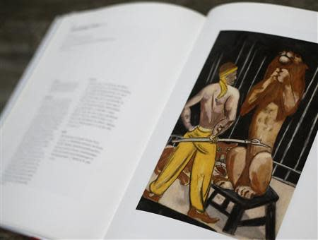 File photo of a print of the painting 'Lion-Tamer' by artist Max Beckmann is displayed in a book about the German expressionist at Lempertz auction house in Cologne November 4, 2013. REUTERS/Wolfgang Rattay/Files