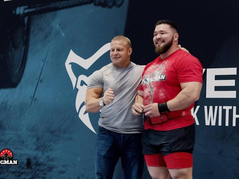 Kim Ujarak Lorentzen, right, won Greenland's strongest man competition for the fifth year in a row. (Submitted by Kim Ujarak Lorentzen - image credit)