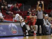 Cincinnati guard Deshaun Morman (1) is knocked out of bounds by the Stony Brook guard Carson Puriefoy (10) in the first half of an NCAA college basketball game, Tuesday, Dec. 2, 2014, in Cincinnati. (AP Photo/Frank Victores)