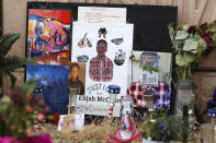 FILE - In this July 3, 2020, file photo, a makeshift memorial stands at a site across the street from where Elijah McClain was stopped by police officers while walking home in Aurora, Colo. A drug called ketamine that's injected as a sedative during arrests has drawn new scrutiny since a young Black man named Elijah McClain died in suburban Denver. An analysis by The Associated Press of policies on ketamine and cases where it was used nationwide uncovered a lack of police training, conflicting medical standards and nonexistent protocols that have resulted in hospitalizations and even deaths. (AP Photo/David Zalubowski, File)