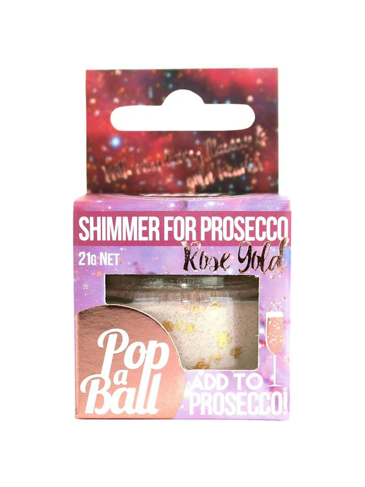 """<p>Fancy pimping your prosecco? Then you'll be needing some of this stuff! This shimmer powder will make your guests feel as though there at some kind of celeb birthday bash with a professional mixologist making bespoke jazzy cocktails. But nope, it's just you in your flat. </p><p><a class=""""body-btn-link"""" href=""""https://go.redirectingat.com?id=127X1599956&url=https%3A%2F%2Fwww.johnlewis.com%2Fpopaball-rose-gold-shimmer-powder-21g%2Fp3617094&sref=http%3A%2F%2Fwww.delish.com%2Fuk%2Fcocktails-drinks%2Fg29855274%2Falcoholic-gift-guide%2F"""" target=""""_blank"""">BUY NOW</a> <strong>£7.50, John Lewis </strong><strong><br></strong></p>"""