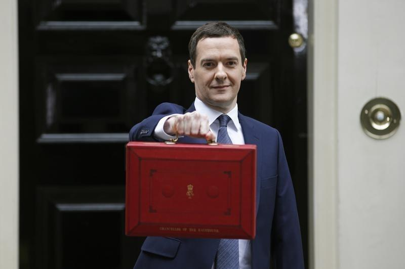 Britain's Chancellor George Osborne holds up his budget case as he stands outside number 11 Downing Street before delivering his budget to the House of Commons