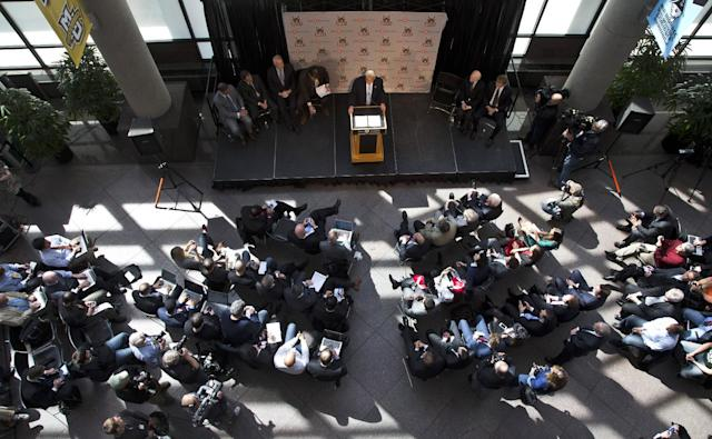 Milwaukee Bucks owner Herb Kohl, seated second from right on stage, listens as investment firm executive Wesley Edens speaks at a news conference Wednesday, April 16, 2014, in Milwaukee. Kohl has reached a deal to sell the NBA basketball franchise to Edens and Marc Lasry for about $550 million.The deal is subject to approval by the NBA and its Board of Governors. (AP Photo/Morry Gash)