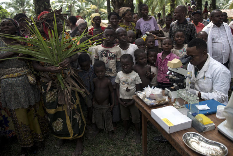 Doctors test for sleeping sickness in a remote Congolese village. (Neil Brandvold/DNDi)