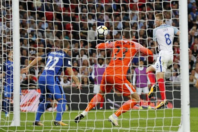 England's Eric Dier (R) shoots past Slovakia's goalkeeper Martin Dubravka to score equalizer during their 2018 FIFA World Cup qualifier match, at Wembley Stadium in London, on September 4, 2017 (AFP Photo/Adrian DENNIS)