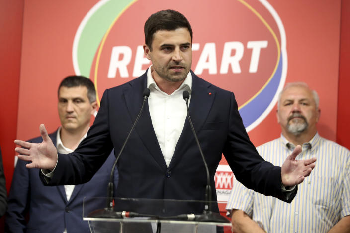 Opposition leader Davor Bernardic of the liberal-left Restart coalition addresses his supporters in Zagreb, Croatia, Sunday, July 5, 2020. The ruling conservatives overwhelmingly won Croatia's parliamentary elections held Sunday amid a spike in new coronavirus cases as the latest European Union member state leaned further to the right. SDP leader Bernardic conceded the defeat and suggested he would resign the leadership position. (AP Photo/Daniel Kasap)