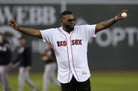 Former Boston Red Sox's David Ortiz gets ready to throw out a ceremonial first pitch before a baseball game against the New York Yankees in Boston, Monday, Sept. 9, 2019. (AP Photo/Michael Dwyer)