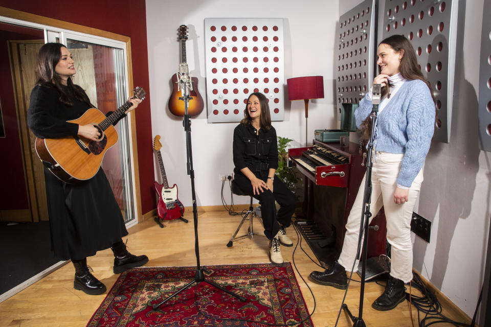"""Members of the folk group The Staves, from left, sisters, Jessica, Emily and Camilla Staveley-Taylor appear in a north London recording studio, on Feb. 15, 2021. The Staves released their third album, """"Good Woman,"""" last month. (Photo by Joel C Ryan/Invision/AP)"""