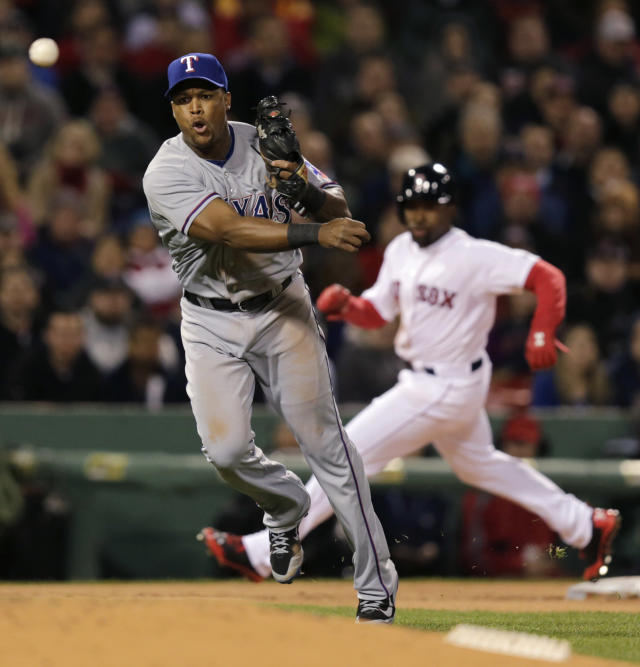 Texas Rangers third baseman Adrian Beltre, left, makes the throw on a bases loaded ground out by Boston Red Sox's Dustin Pedroia to end the second inning of a MLB American League baseball game at Fenway Park, Monday, April 7, 2014, in Boston. At rear rounding third is Red Sox Jackie Bradley Jr. (AP Photo/Charles Krupa)
