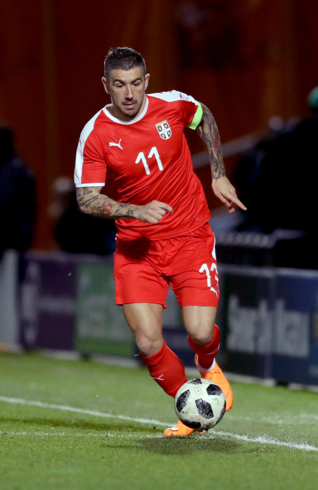 In this photo taken on Tuesday, March 27, 2018, Serbia's Aleksandar Kolarov runs with the ball during the international friendly soccer match between Serbia and Nigeria at The Hive Stadium in London. (AP Photo/Matt Dunham)