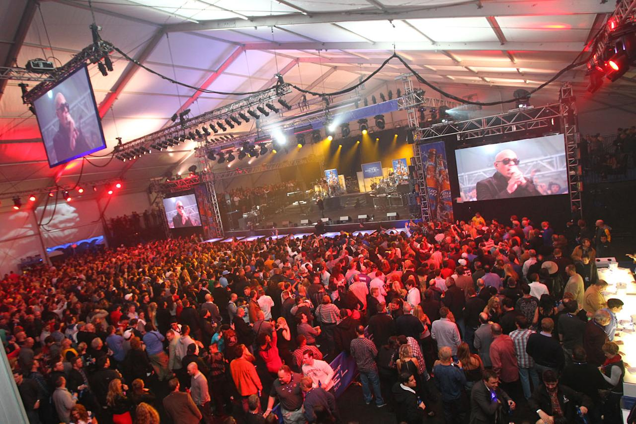 Concertgoers enjoy performances from 50 Cent and Pitbull at the Bud Light Hotel in Indianapolis.