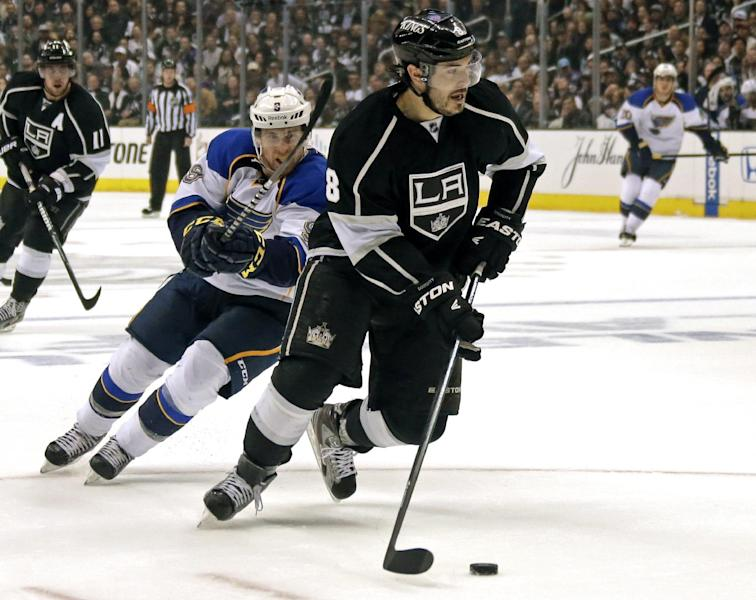 Los Angeles Kings defenseman Drew Doughty (8) moves the puck as he is chased by St. Louis Blues left winger Jaden Schwartz (9) in the first period of Game 4 of the NHL Western Conference Stanley Cup hockey playoff series in Los Angeles, Monday, May 6, 2013. (AP Photo/Reed Saxon)