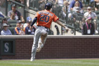 Houston Astros Chas McCormick points to home plate after scoring on a single by Houston Astros' Aledmys Diaz during the fourth inning of a baseball game against the Seattle Mariners, Wednesday, July 28, 2021, in Seattle. (AP Photo/Jason Redmond)