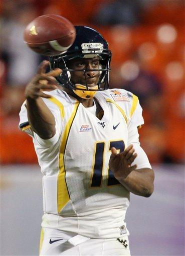 West Virginia quarterback Geno Smith (12) throws the ball during the second half of the Orange Bowl NCAA college football game against Clemson, Wednesday, Jan. 4, 2012, in Miami. (AP Photo/J. Pat Carter)