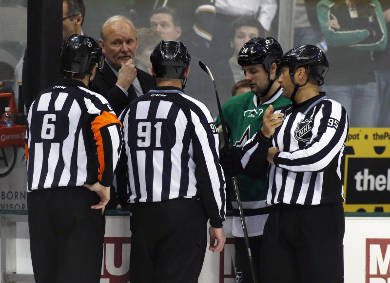 Dallas Stars head coach Lindy Ruff and center Jamie Benn talk to the referees Francis Charron (6), Don Henderson (91) and Jonny Murray (95) after play was stopped in the first period of an NHL Hockey game against the Columbus Blue Jackets Monday, March 10, 2014, in Dallas. Center Rich Peverly was taken to a hospital after a medical emergency. (AP Photo/Sharon Ellman)