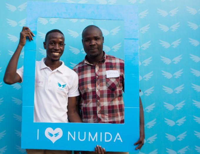 Two business people using Numida