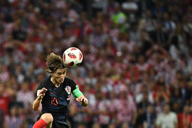 <p>Luka Modric sle in cielo a caccia del pallone. / AFP PHOTO / FRANCK FIFE / RESTRICTED TO EDITORIAL USE – NO MOBILE PUSH ALERTS/DOWNLOADS </p>