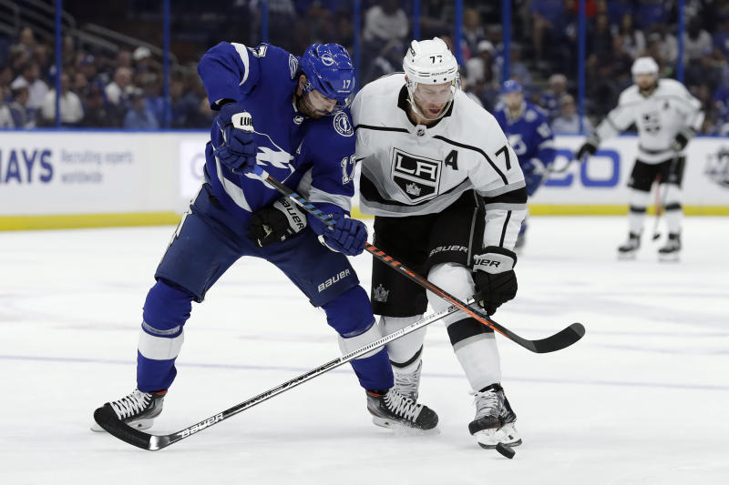 Los Angeles Kings center Jeff Carter (77) knocks the puck away from Tampa Bay Lightning left wing Alex Killorn (17) during the first period of an NHL hockey game Tuesday, Jan. 14, 2020, in Tampa, Fla. (AP Photo/Chris O'Meara)