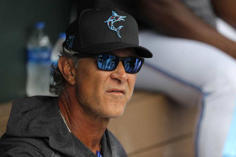 FILE - Miami Marlins manager Don Mattingly looks on from the dugout prior to a spring training baseball game against the Washington Nationals in Jupiter, Fla., in this Tuesday, March 10, 2020, file photo. Mattingly's job remains to develop young talent so an underfinanced team can overachieve. He considers his ability to relate to players one of his strengths, perhaps because he was an overachiever himself. (AP Photo/Julio Cortez, File)