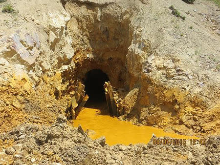 Yellow mine waste water is seen at the entrance to the Gold King Mine in San Juan County, Colorado, August 5, 2015.  REUTERS/EPA/Handout