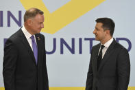 Ukrainian President Volodymyr Zelenskyy, right, and Polish President Andrzej Duda talk during the Crimean Platform Summit in Kyiv, Ukraine, Monday, Aug. 23, 2021. The Crimea Platform is a new international consultation and coordination format to strengthen an international response to the ongoing Russia's occupation of Crimea. (Ukrainian Presidential Press Office via AP)
