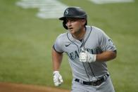 Seattle Mariners' Kyle Seager crosses the plate after hitting a two-run home run during the first inning of the team's baseball game against the Texas Rangers in Arlington, Texas, Saturday, July 31, 2021. (AP Photo/Tony Gutierrez)