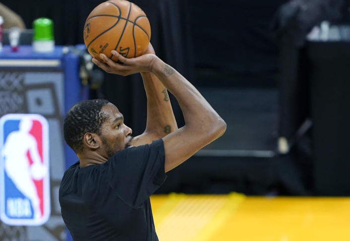 Kevin Durant #7 of the Brooklyn Nets warms up prior to the start of an NBA basketball game against the Golden State Warriors at Chase Center on February 13, 2021 in San Francisco, California. NOTE TO USER: User expressly acknowledges and agrees that, by downloading and or using this photograph, User is consenting to the terms and conditions of the Getty Images License Agreement. (Photo by Thearon W. Henderson/Getty Images)