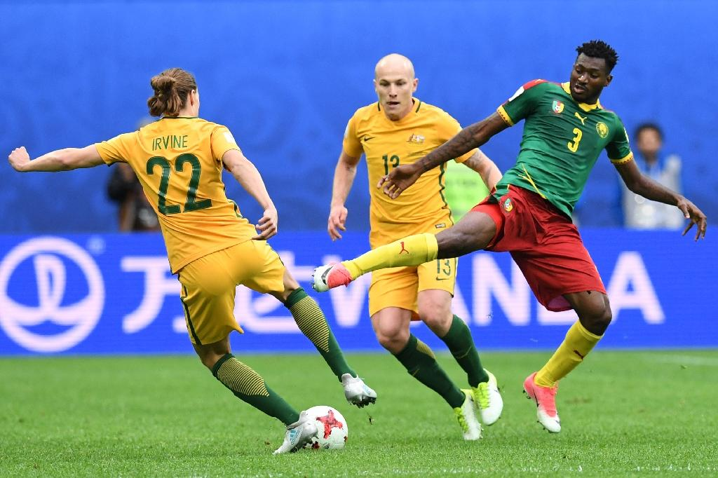 Australia's midfielder Jackson Irvine (L) vies for the ball against Cameroon's midfielder Andre Zambo during the 2017 Confederations Cup group B football match between Cameroon and Australia, which resulted in a draw (AFP Photo/Kirill KUDRYAVTSEV)
