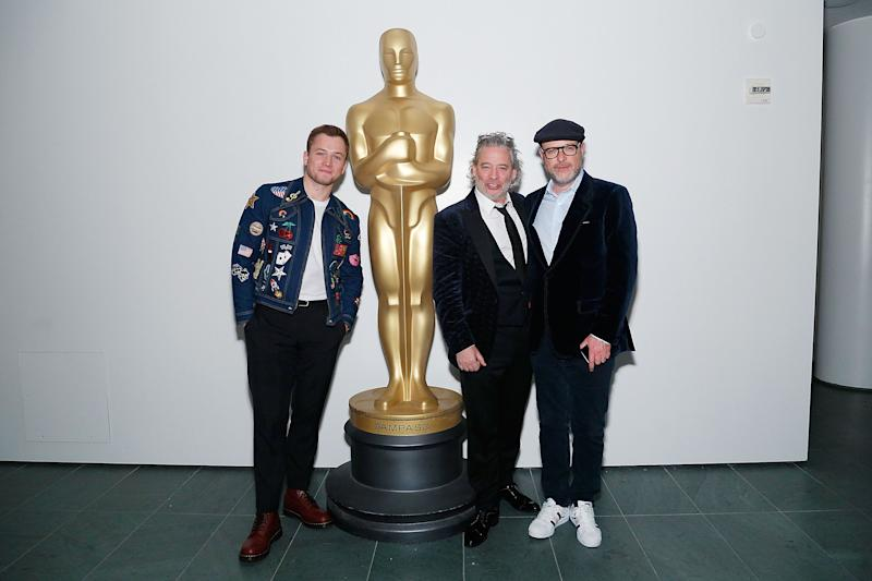 "NEW YORK, NY - MAY 29: (L-R) Actor Taron Egerton, director Dexter Fletcher and producer Matthew Vaughn attend The Academy of Motion Picture Arts and Sciences official screening of ""Rocketman"" at the MoMA, Celeste Bartos Theater on May 29, 2019 in New York City. (Photo by Lars Niki/Getty Images for The Academy Of Motion Picture Arts & Sciences)"