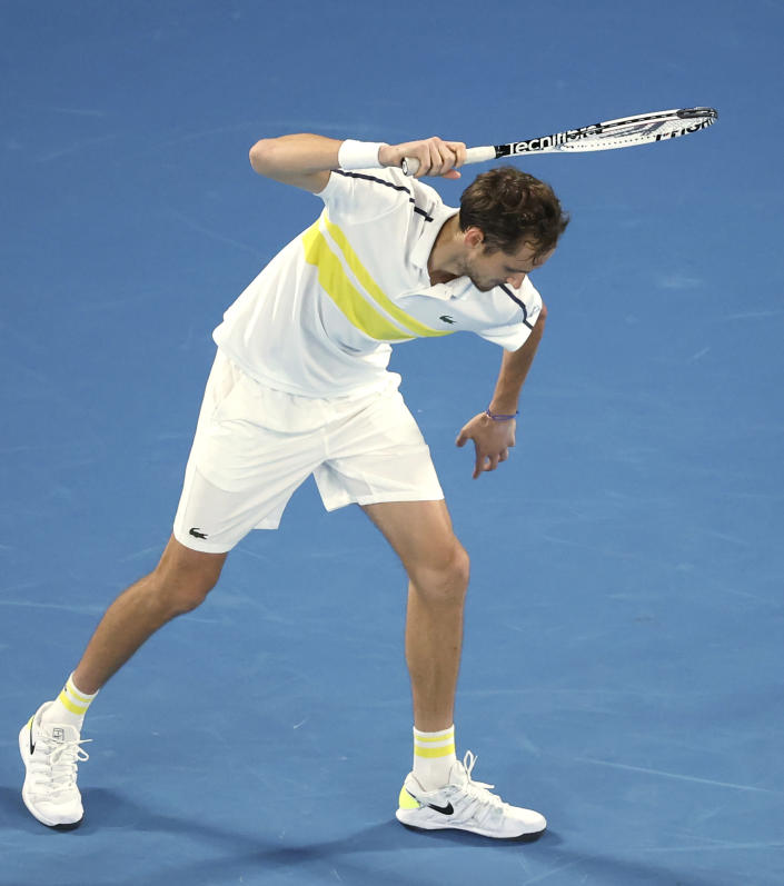 Russia's Daniil Medvedev raises his racket as if to smash it on the court while playing Serbia's Novak Djokovic during the men's singles final at the Australian Open tennis championship in Melbourne, Australia, Sunday, Feb. 21, 2021. (AP Photo/Hamish Blair)