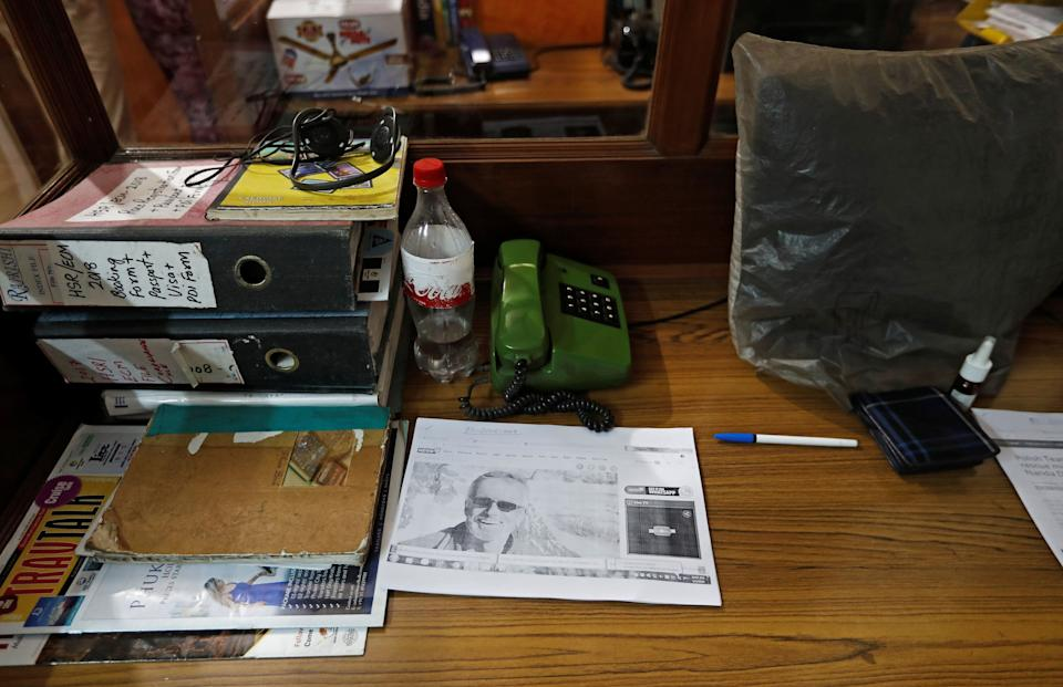 A picture of missing British climber Martin Moran is seen inside the office where the search is being co-ordinated (Picture: Reuters)