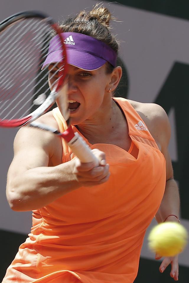Romania's Simona Halep returns the ball during the third round match of the French Open tennis tournament against Spain's Maria-Teresa Torro-Flor at the Roland Garros stadium, in Paris, France, Saturday, May 31, 2014. (AP Photo/Michel Euler)