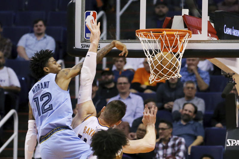 Next time, Aron Baynes should just let Ja Morant go. (AP Photo/Ross D. Franklin)