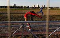 A woman stretches after her show on the stage outside the stadium in Kaliningrad, Russia, June 28, 2018. REUTERS/Kacper Pempel