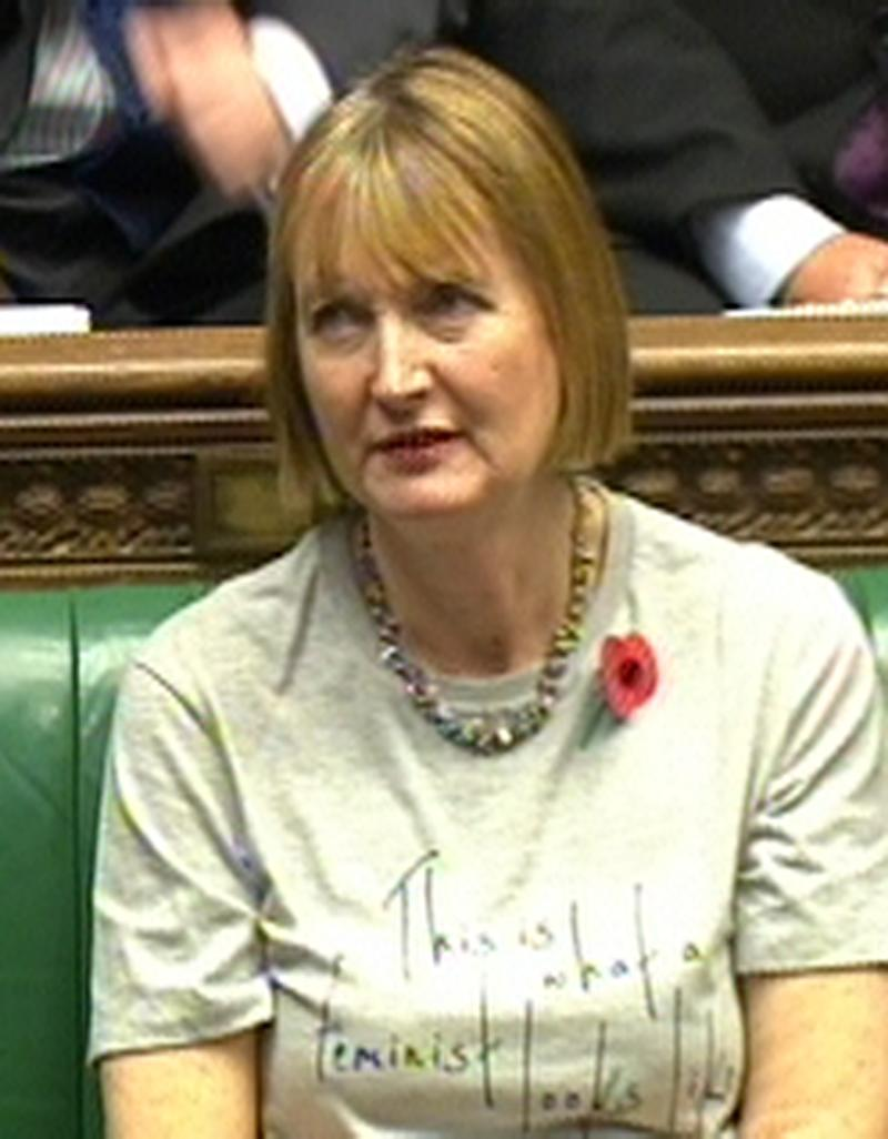 Deputy leader of the Labour party Harriet Harman wears a feminist T-shirt during Prime Minister's Questions in the House of Commons, London.
