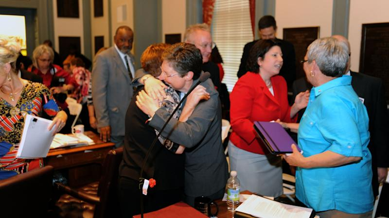CORRECTS CITY TO DOVER INSTEAD OF WILMINGTON - Lawmakers celebrate after a bill making Delaware the 11th state in the nation to allow same-sex marriage passed in the senate, Tuesday, May 7, 2013 in Dover, Del. (AP Photo/The Wilmington News-Journal, Gary Emeigh)  NO SALES