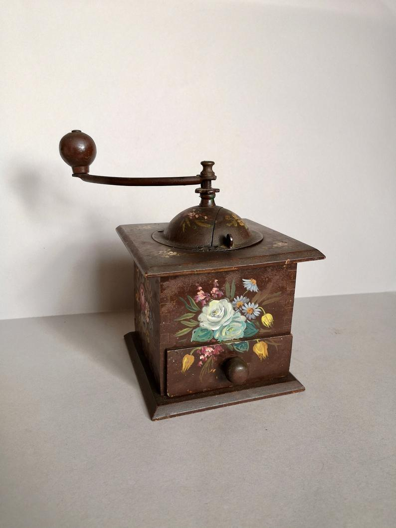 "This vintage coffee grinder is handpainted and in great working condition – perfect for preparing your morning brew or just displaying as part of your home's <a href=""https://www.refinery29.com/en-gb/lockdown-clutter-home"" rel=""nofollow noopener"" target=""_blank"" data-ylk=""slk:charming clutter"" class=""link rapid-noclick-resp"">charming clutter</a>.<br><br><strong>Peugeot Freres</strong> Hand Painted 1900s Coffee Grinder, $, available at <a href=""https://www.etsy.com/uk/listing/875368154/a-lovely-working-hand-painted-vintage?"" rel=""nofollow noopener"" target=""_blank"" data-ylk=""slk:Etsy"" class=""link rapid-noclick-resp"">Etsy</a>"