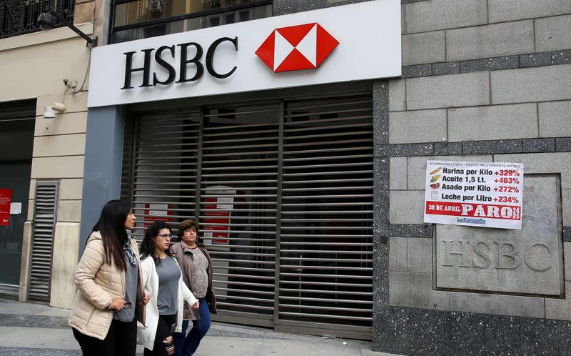 Pedestrians walk past closed HSBC bank during a national strike in Buenos Aires