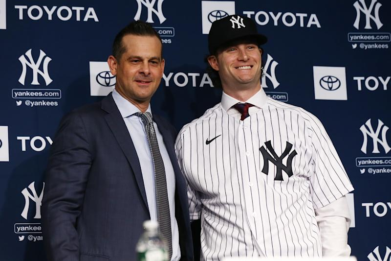 NEW YORK, NEW YORK - DECEMBER 18: Gerrit Cole and Manager, Aaron Boone of the New York Yankees pose for a photo at Yankee Stadium during a press conference at Yankee Stadium on December 18, 2019 in New York City. (Photo by Mike Stobe/Getty Images)