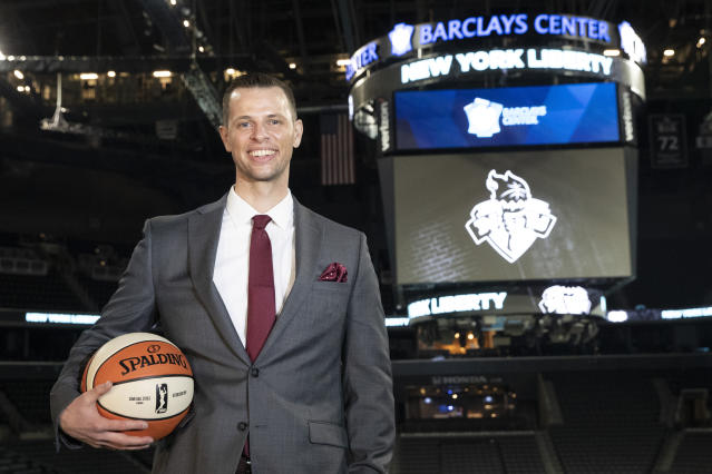 New York Liberty WNBA basketball team new head coach Walt Hopkins poses for photographers after a news conference at Barclays Center, Wednesday, Jan. 8, 2020, in New York. (AP Photo/Mary Altaffer)