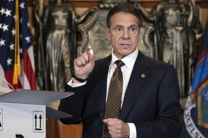 In this Dec. 3, 2020, photo provided by the Office of Gov. Andrew Cuomo, Cuomo holds up samples of empty packaging for the COVID-19 vaccine during a news conference in the Red Room at the State Capitol in Albany, N.Y. Cuomo is one of several contenders under consideration by President-elect Joe Biden for the role of attorney general. (Mike Groll/Office of Governor of Andrew M. Cuomo via AP)
