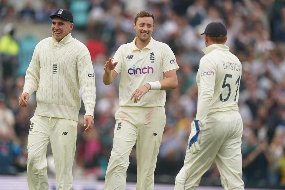 Ollie Robinson (centre) celebrates taking the wicket of India's Rohit Sharma (Adam Davy/PA) (PA Wire)